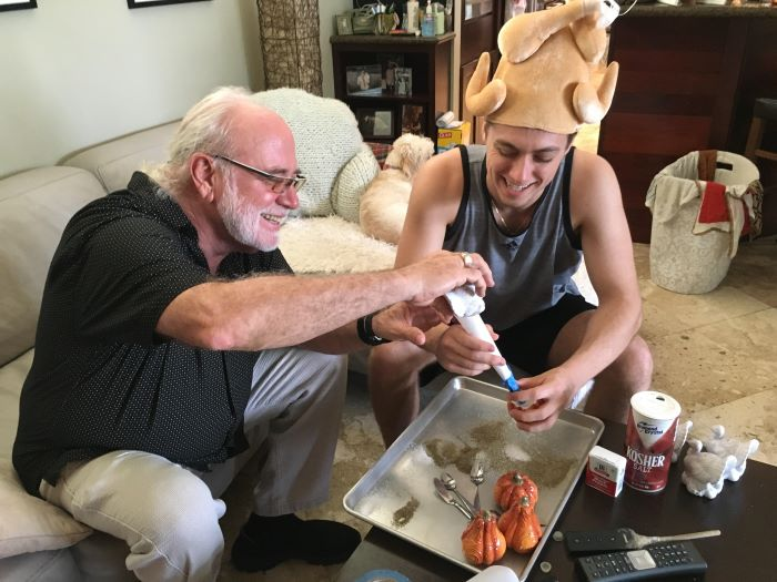 Grandfather and Grandson filling Thanksgiving salt shakers